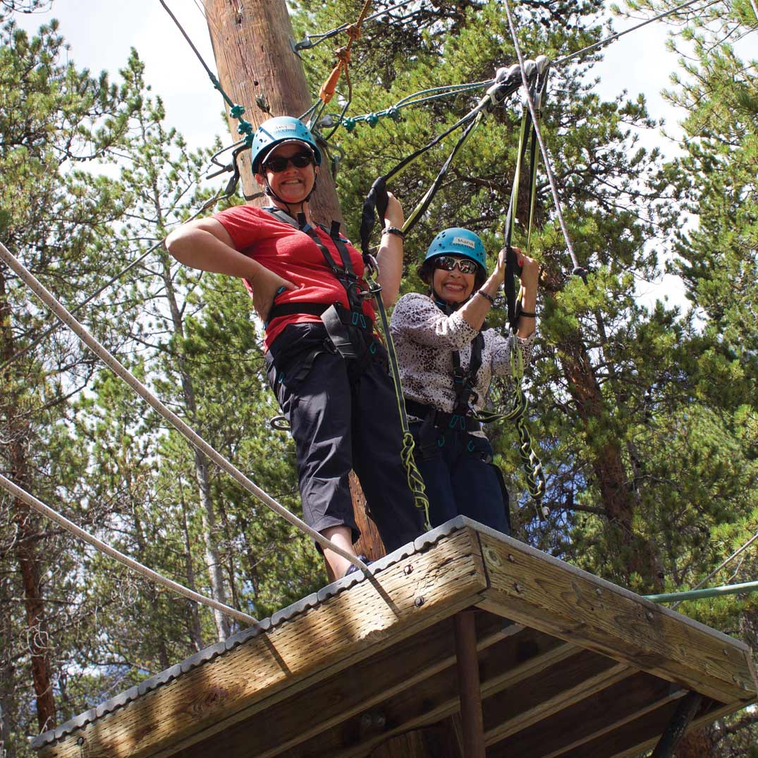 Participants on BOEC's Accessible High Ropes Course