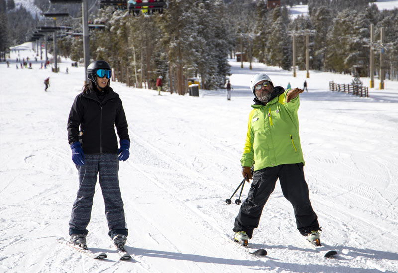 BOEC Instructor, J.J., Skis with Mountain Mentors' Naaila Ahmad