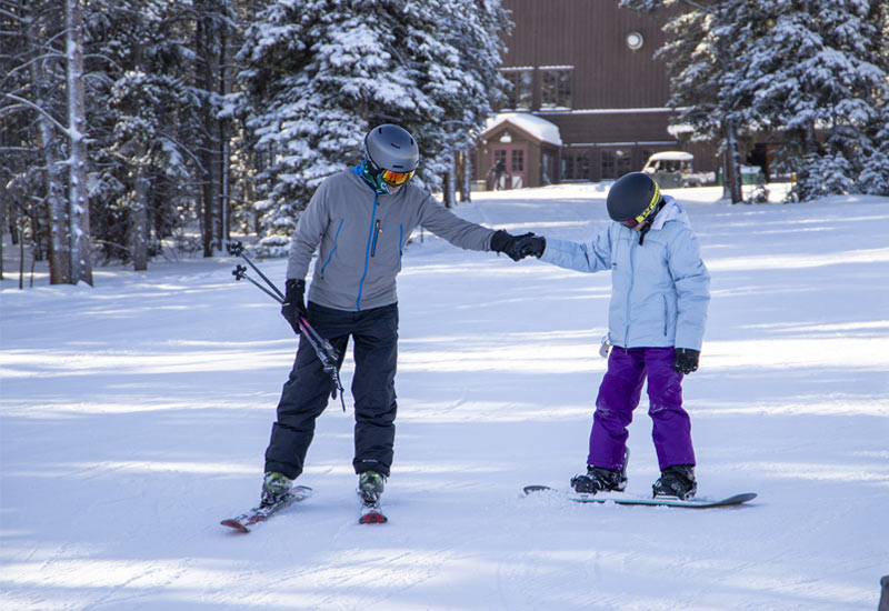 Alpine Bank Regional President, Matt Hanson, Skis with SSA Participant