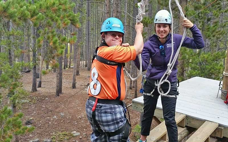 Kat with ropes course participant