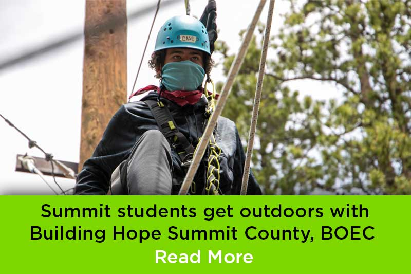 Summit student on BOEC ropes course