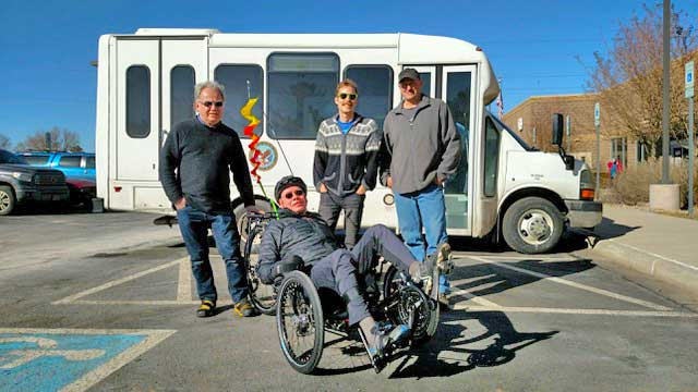 Josiah, Kirk & Kelvin pose with a happy adaptive cycling customer