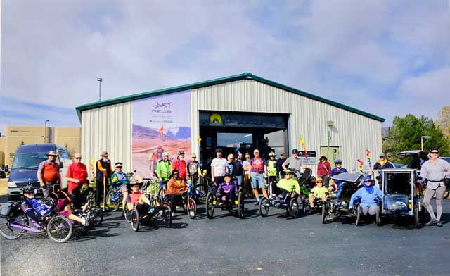 Adaptive cycling crew in front of the Angletech shop