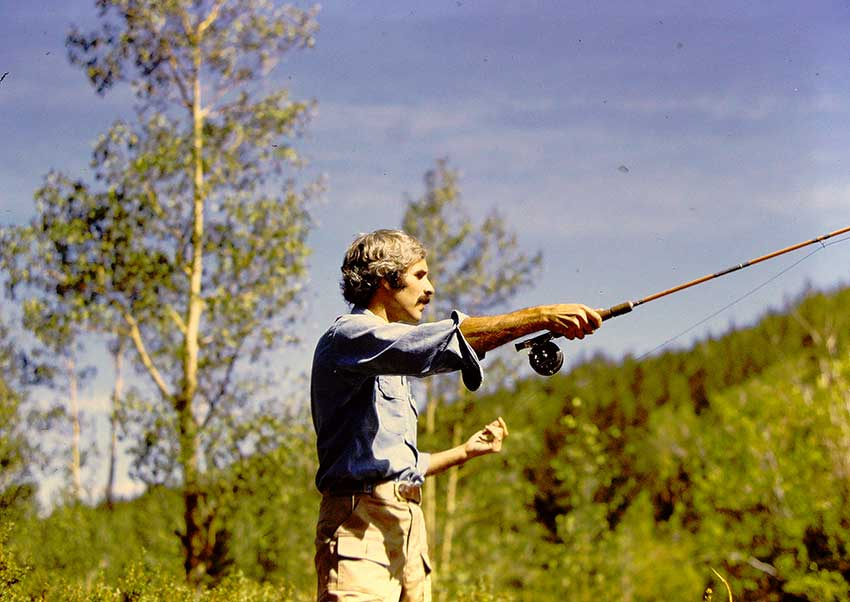 Dr. Aris Sophocles fly fishing in his spare time