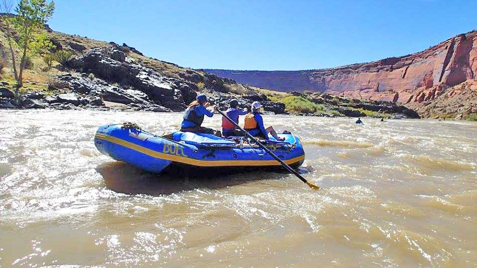 Claire guiding a BOEC raft trip
