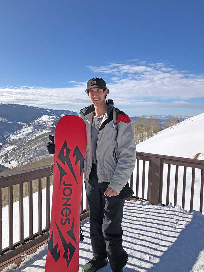 Austin poses with his snowboard