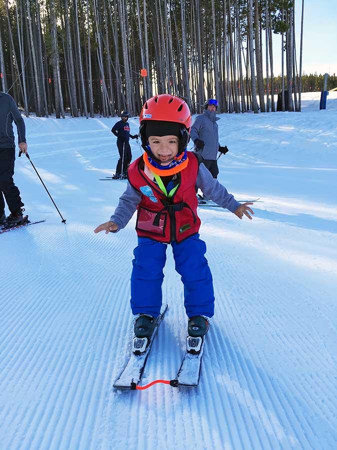 Finnegan enjoying an adaptive ski lesson