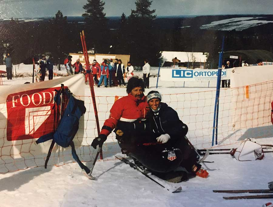Cathy with an adaptive ski participant