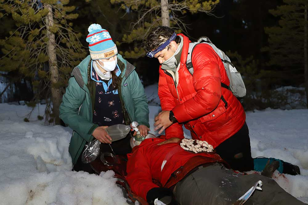 Breck Wild medical students attend to a crash victim