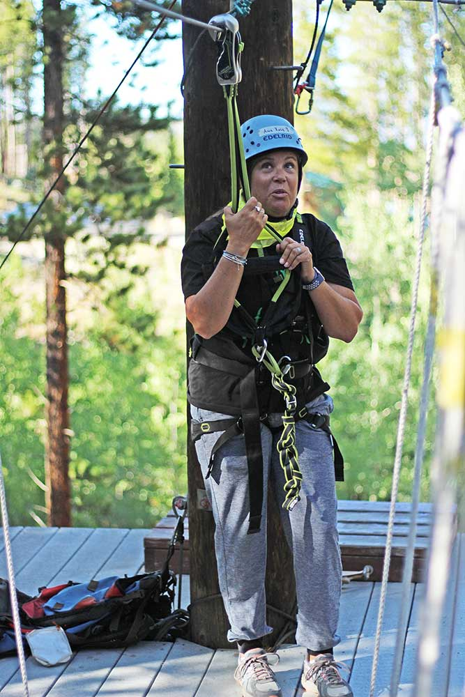 Stacy of Club Forget Me Not tackles the ropes course