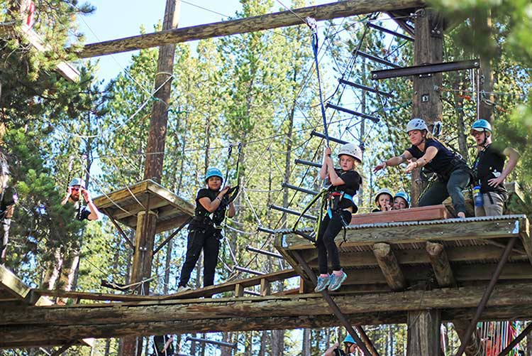 Club Forget Me Not Participants tackle the ropes course