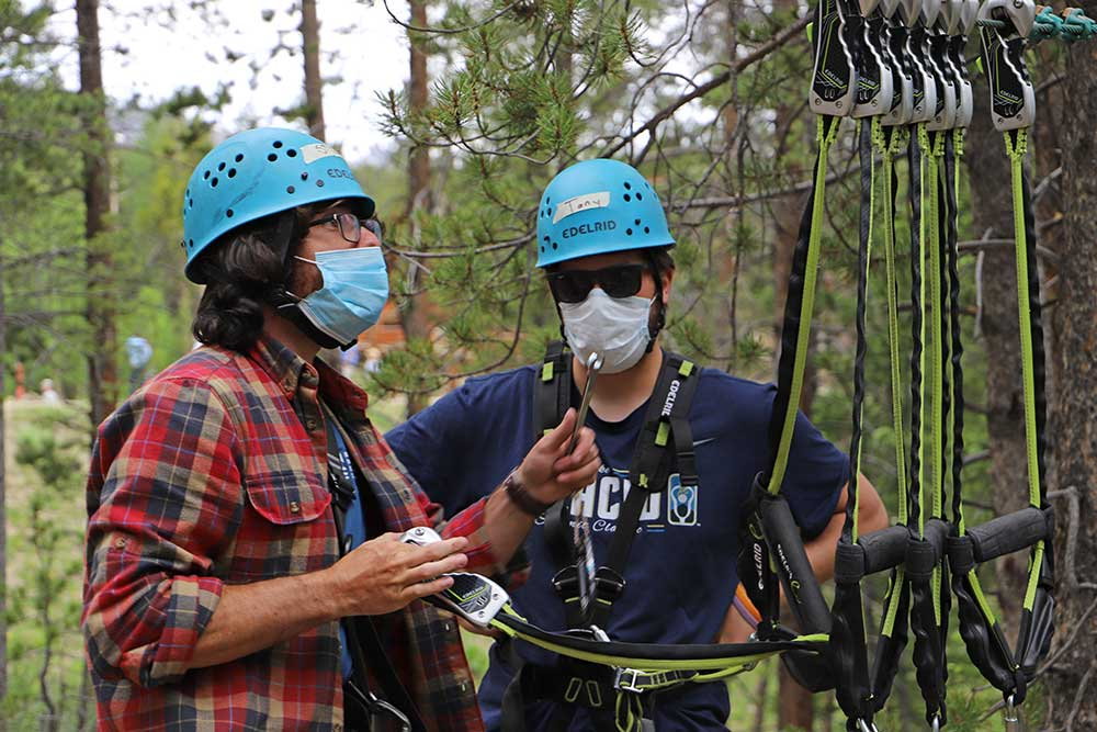 Steve helps with the ropes course belay system training
