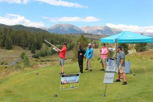 Participants try their hand at the ifurnish golf ball launcher