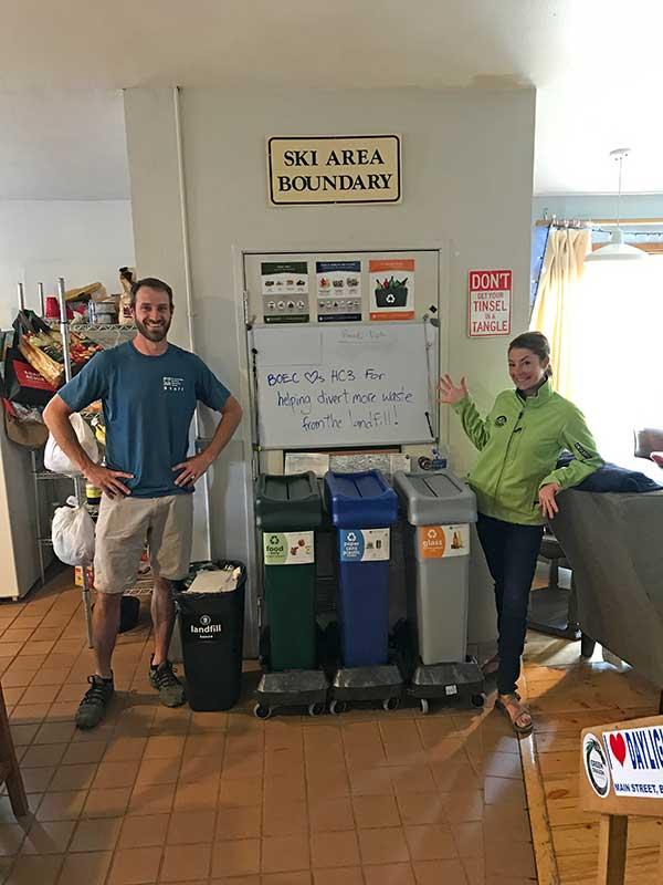 Hallie and BOEC's Ben Hickman show off the bins