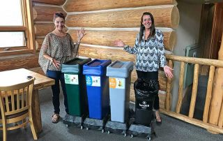 Hallie and Allie pose with new recycling bins